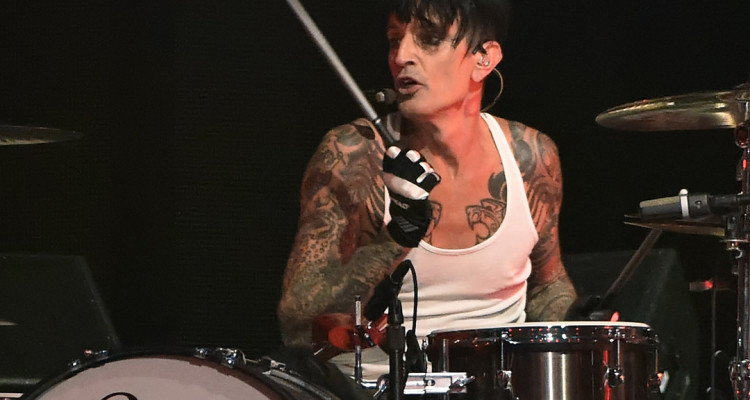 LAS VEGAS, NV - SEPTEMBER 19:  Drummer Tommy Lee (C) of Motley Crue performs during the 2014 iHeartRadio Music Festival at the MGM Grand Garden Arena on September 19, 2014 in Las Vegas, Nevada.  (Photo by Ethan Miller/Getty Images for iHeartMedia)